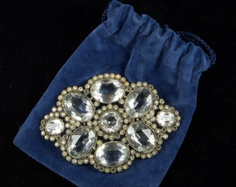 Victorian splendor! Brooch in clear stones set in dark metal.  Great costuming or added drama on the simple dress.