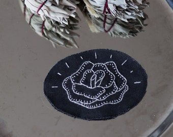 rose patch on black ovale patch handstitched embroidery black punk goth traditional tattoo
