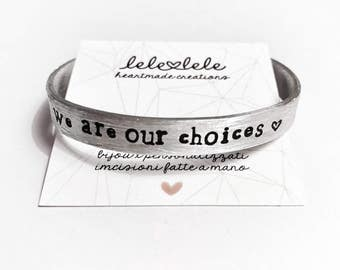 Custom band 0.6-0.8 cm (2 mm thick) in aluminium with personalized phrase engraved by hand