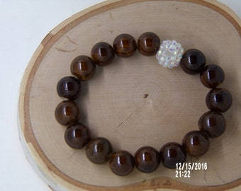 B1250 Brown Ceramic Bracelet with White crystal connector.
