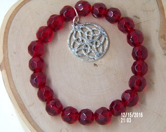 B1252  Red Glass Beaded Bracelet with small Celtic Charm.