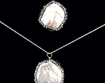 Coin style Freshwater Baroque Pearl Pendant on sterling silver rope chain.