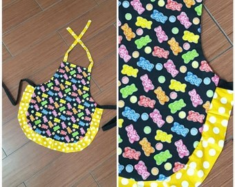 3 or 4 year old mini child apron. Girl apron. Colorful gummy bears on black with yellow polka dot frills.