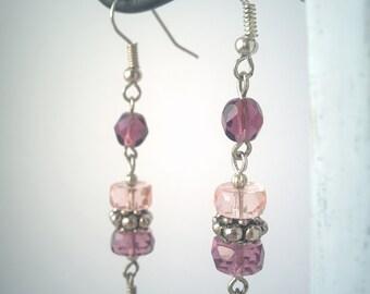 Long dangle purple creamy earrings with metal details
