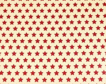 Laminated cotton fabric joyful Christmas star red on cream (17.50 EUR / meter)