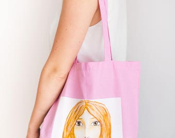 Tote bag with printed illustration of female face