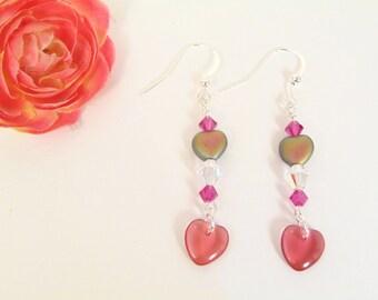 Light heart dangle earrings with Swarovski crystals.
