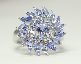 Silver ring with natural faceted tanzanites