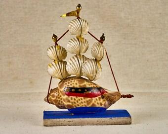 Small ship made of seashells. Vintage Japanese souvenir.