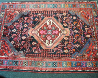 Authentic Persian rug is hand size 155cmx115cm wool