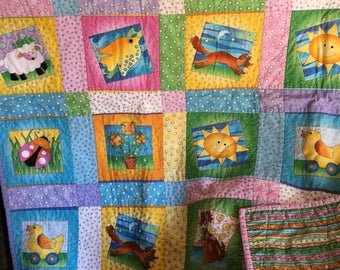 Cute baby quilt with various colors.37x44