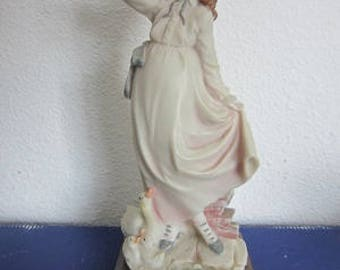 Belcari Italy sculpture young lady with ducks, biscuit, DEAR 1985