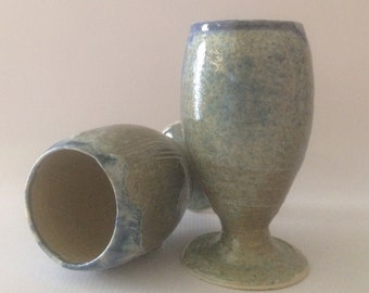 A pair of Blue green water goblets