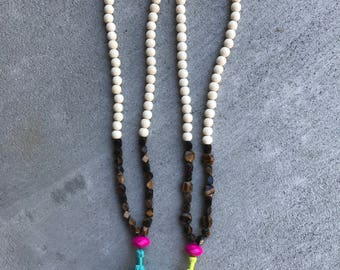 Faceted bead and Tassel necklace
