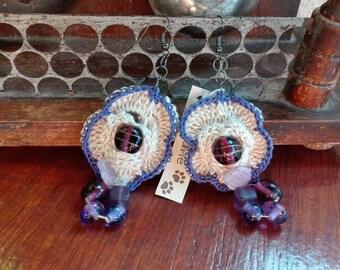 Crochet Flower Earrings with purple glass beads.