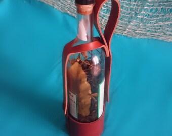 Handmade leather bottle holder. Porta bottiglia in pelle fatto a mano.