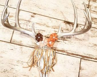 flower and fringe deer skull