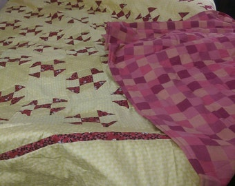 Red and pale yellow Queen size cotton quilt.