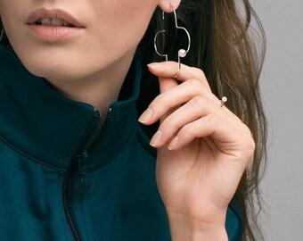 Oversize pearl earring, big silver cross,  minimalist flower shape, bead earrings, modern, minimal, geometric jewelry, contemporary design