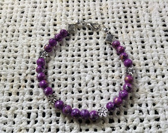 Purple bracelet with pewter flower accents