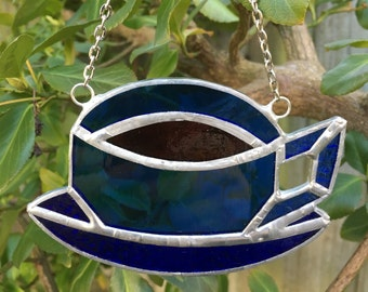 Hand crafted stained glass multi coloured Teacup sun catcher.