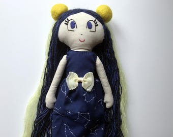Handmade doll with shining stars at night dress