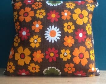 A pair of groovy 1960's cushions professionally upholstered in fabric from the mid 20th century