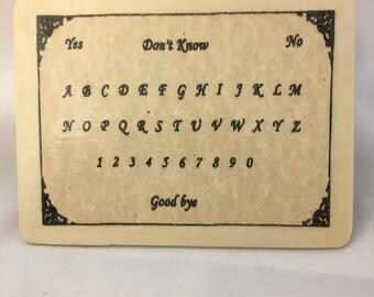 """5"""" x 6"""" Ouija board."""
