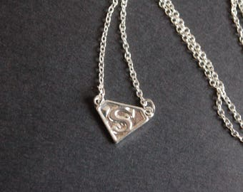 silver tone superman necklace