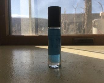 1/3 oz roll on bottle of D&G (M) type perfume oil