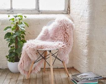 Shaggy pink faux fur rug