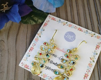 Earrings of gold wire and stones