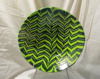 Fused glass combed bowl in greens and clear