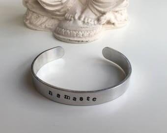 Aluminum cuff bracelet Namaste