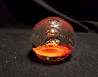 Round Glass Paperweight Red bottom and 3 suspended bubbles