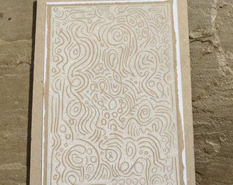 Swirls and circles linocut in chalk white ink on recycled paper grteetings card