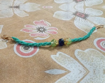 Bracelet with twisted bead strands