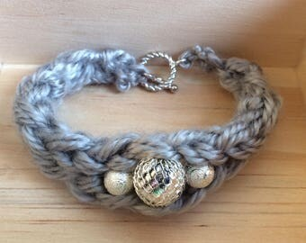 Hand knit gray bracelet with silver beads