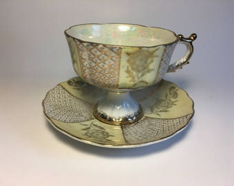 Norleans Lustreware Teacup and Saucer – Creamy Yellow, White, and Gold – Alternate Floral and Fish Scale Design – Meito Company, Japan