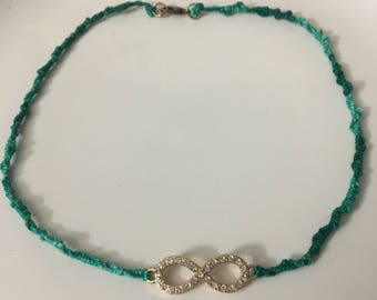 Woven Green Necklace with Infinity Pendant