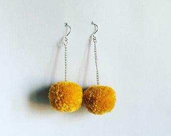 mustard pompoms small