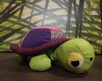 Green and purple turtle plush