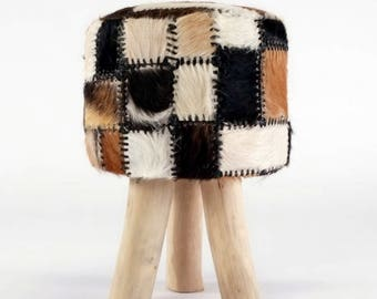 Coat stools made from goat skin around with wooden feet, brown white black tricolor