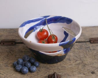 Blue and white serving bowl with cut outs