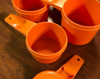 Orange Tupperware Meauring Cups