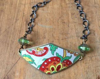 Red, orange, and green vintage tin bracelet