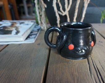 Hand thrown, ceramic, Vampire Bunny Mug
