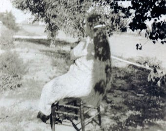 vintage photo 1921 Woman In Chair From Back She Sits on Her Long hair Unusual Abstract