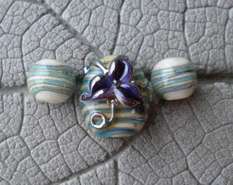 Purple Floral Glass Focal Pair Lampwork Beads by Cherie Sra R114 Flamework Glass Bead Encased Silver Glass on Ivory Purple Flower Pair