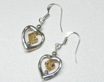 heart shaped dangle earrings with amber swarovski crystals,amber crystal dangle earrings,heart dangle earrings,silver dangle earrings
